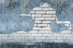 Old wall with bricks and cracked plaster Royalty Free Stock Image