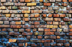 Old wall of broken colored brick. Wall of a collapsed building royalty free stock images