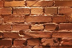 Old wall of broken red brick, texture, background. Close-up royalty free stock photos