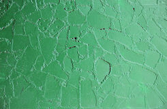old wall at the bus stop, painted green paint on top of the cladding tiles Stock Photo