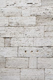 Old wall of calcareous blocks Stock Photos