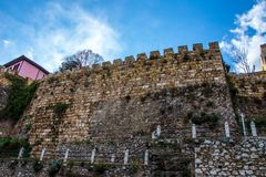 Old wall of the castle from ottoman period. Old wall of the castlle from ottoman period near the roud in city of Bursa Turkey Stock Images