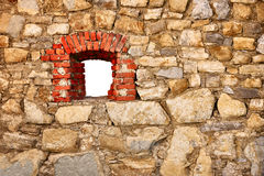 Old wall of castle with a window Royalty Free Stock Image