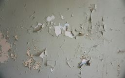 Old wall with chipped paint. Old wall: chipped, partially peeled-off white, beige and green paint stock image