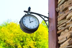 Old wall clock on side ancient tower downtown. Stock Photo