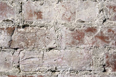 Old wall close up. Very old red brick wall close up. Background Royalty Free Stock Photo