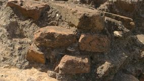 Old wall close up. Damaged structure, bricks and cement. Touch the past stock footage