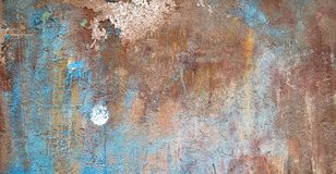 Old wall covered with cracked paint royalty free stock images
