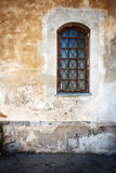 Old wall. Old cracked wall with a window Royalty Free Stock Image