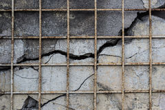 Old wall in the cracks with iron grating. Grunge background Royalty Free Stock Images