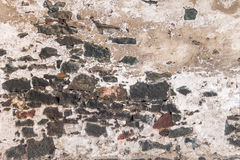 Old wall with crumbled plaster Royalty Free Stock Photo