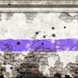 Old wall in decay. Old wall riddled with bullet holes Royalty Free Stock Photo