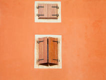 Old wall detail with two windows Royalty Free Stock Photo