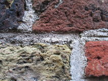 Old wall of different colored stones Royalty Free Stock Photography