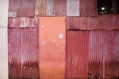 Old wall and door. Red old steel wall and orange door Royalty Free Stock Photos