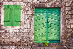 Old wall with door and windows Stock Images