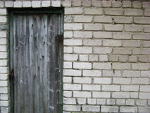 Old wall and doors. Old brick wall and wooden doors royalty free stock image