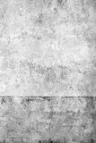 Old wall with falled off paint. Architectural background of an old wall with scratched or fallen off paint Royalty Free Stock Photo