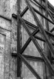 Old wall is falling aparat and has supportive wooden structure. To prevent further damage royalty free stock images