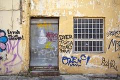 Old wall fill of graffiti. Old urban city house full of graffiti Stock Photography