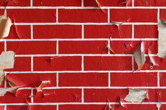 Old wall with flaky paint. Pattern of bricks. Old wall painted in a brick pattern with flaky paint royalty free stock photo