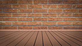 Old wall and floor. Yellow brick wall and brown wooden floor Royalty Free Stock Photo