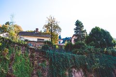 Old wall fortress near the private sector in the small town in Germany. Climbers. stock images