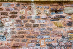 Old wall fragment. Old fragment of a fortress wall Royalty Free Stock Image