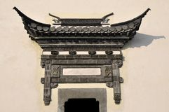 Old wall gate. Traditional Chinese ancient buildings on the door Stock Image