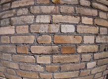 Old wall from gray and brown bricks. Close up with wide angle fisheye lens view stock photo