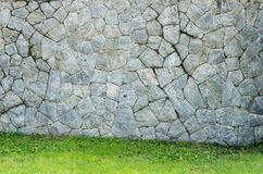 Old wall and green grass background Royalty Free Stock Images