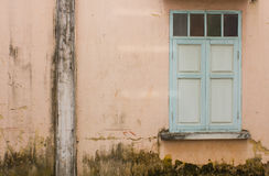 Old wall with green window Royalty Free Stock Image