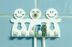 Old wall hanger hook with toothbrush Royalty Free Stock Photos