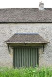 Old wall with hatch / door. Old stone built country building with hatch / door Royalty Free Stock Image