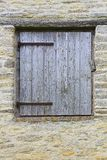 Old wall with hatch / door. Old stone built country building with hatch / door Stock Photos