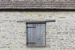Old wall with hatch / door. Old stone built country building with hatch / door Royalty Free Stock Photography