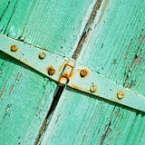 in the old wall a hinged window green wood and rusty metal Royalty Free Stock Photos