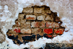 Old wall with hole. Bricks Stock Photo