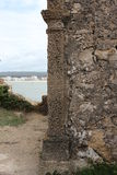 Old wall. From a house with a bay as background from a village - S Martinho do Porto - Portugal Royalty Free Stock Image