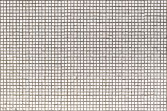 The old wall of the house is decorated with a small white mosaic royalty free stock photography