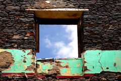 Old wall of house  ruins  and window against sky Royalty Free Stock Image
