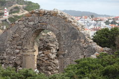Old wall. From a house with a village as background - S Martinho do Porto - Portugal Royalty Free Stock Image