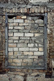 Old wall with immured window Royalty Free Stock Images