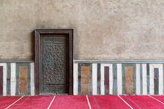 Old wall including a historic decorated bronzed door, Cairo, Egy Royalty Free Stock Photos