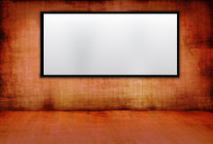 Old wall with lcd. Dark red & dirty  room with lcd Royalty Free Stock Photo
