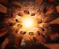 Old wall with lights and flying bricks Stock Images