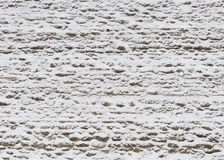 Old wall from limestone powdered with snow in the winter Stock Photos