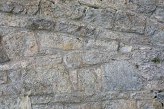 Old wall made of big stones and broken bricks. Vintage rough blocks surface background royalty free stock images