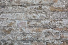 Old wall made of big stones and broken bricks. Vintage rough blocks surface background royalty free stock photos