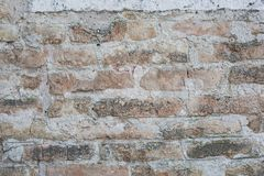 Old wall made of big stones and broken bricks. Vintage rough blocks surface background stock photo